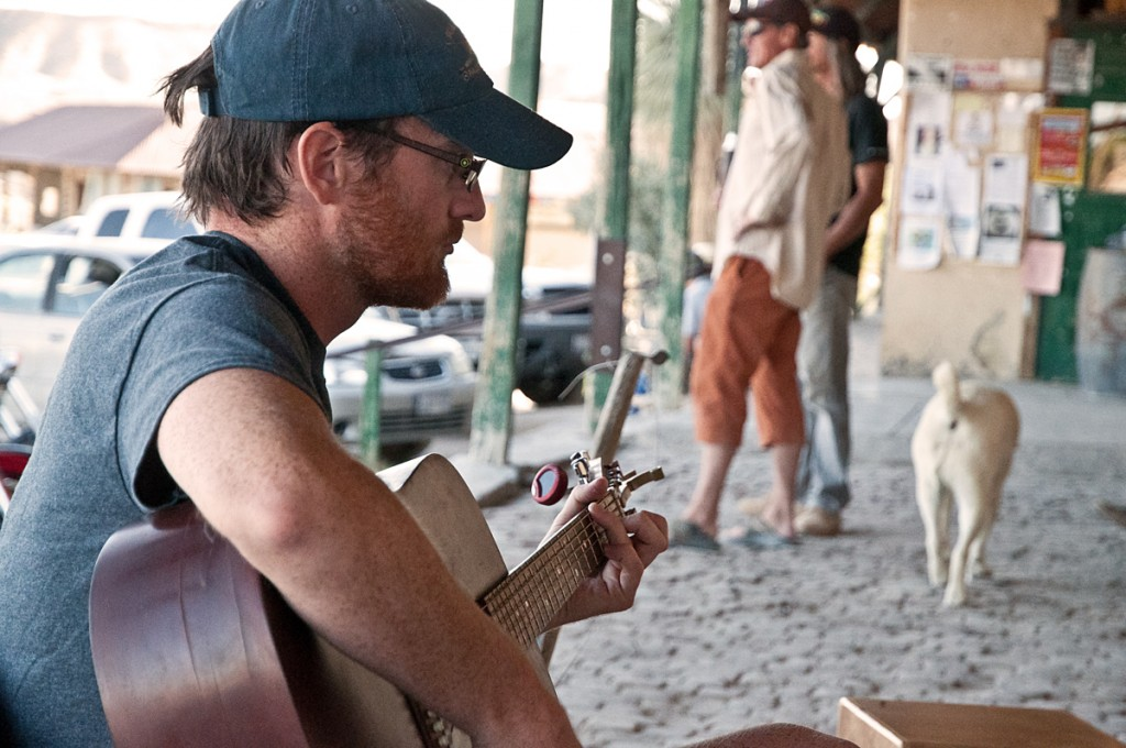 Chase on the porch playing guitar in Terlingua