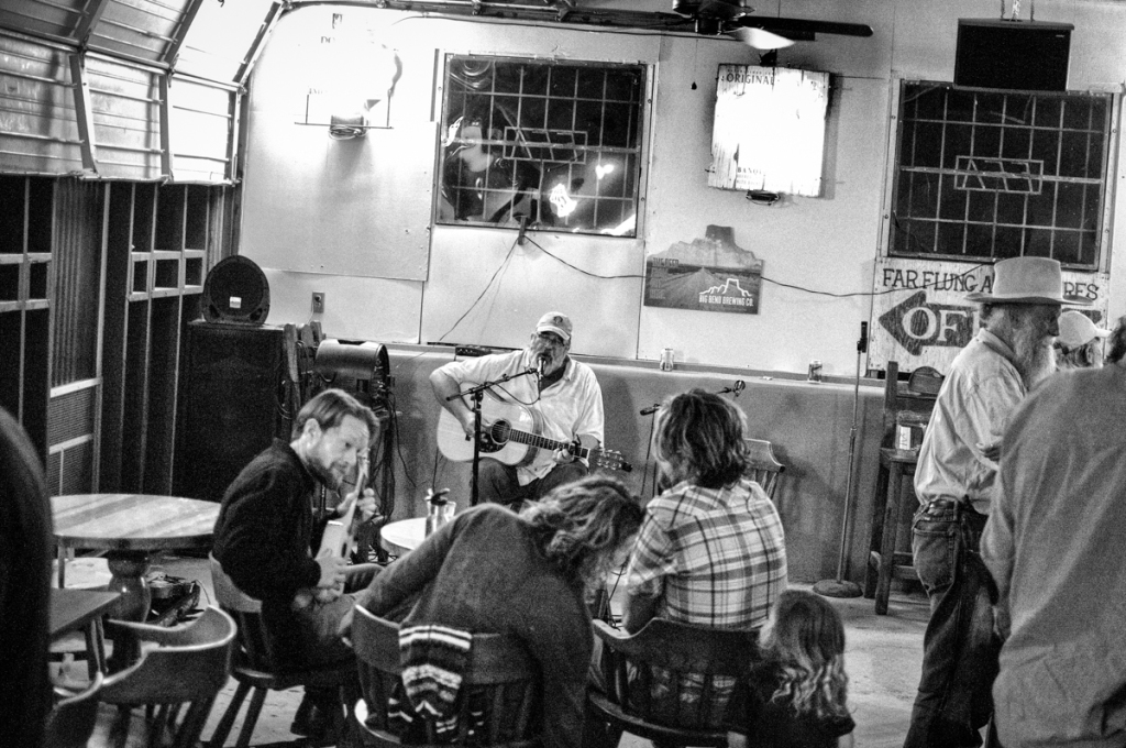 Jeffro Greasewood hosts the open mic at the Boathouse in Terlingua