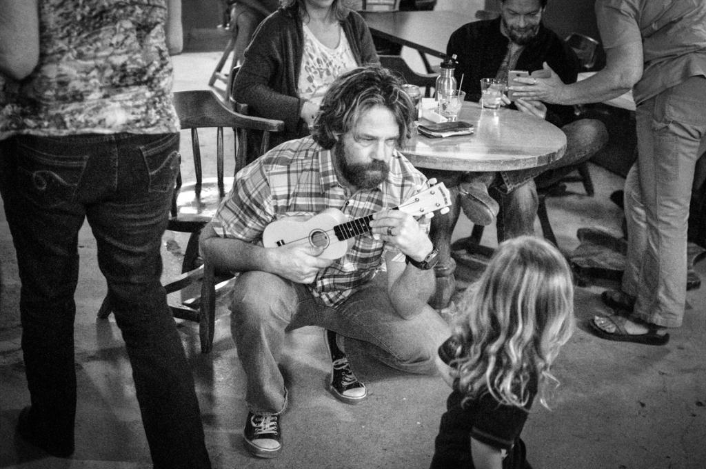 Bob shows Leo how to play the uke