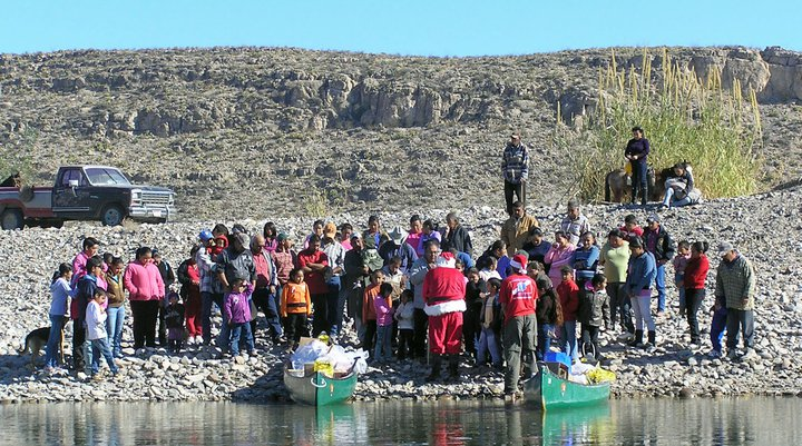 Santa hands out presents to the children of Boquillas