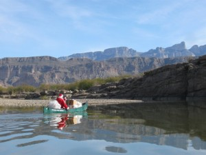 Santa paddling his sleigh to Boquillas