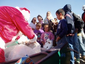Santa delivers toys to the children of Boquillas