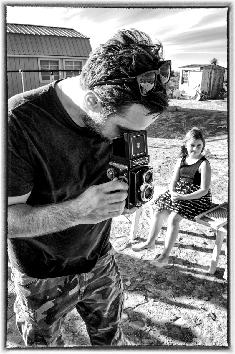 Tony and his Yashica-mat medium format film camera. George and Anita's daughter looks on.